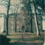 Bridgewater College, Polaroid snapshot of Founders' Hall front with two people walking, undated by Bridgewater College