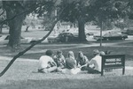 Bridgewater College, Students sitting in a group by Founders' Hall sign, undated by Bridgewater College