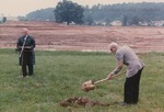 Bridgewater College, Francis Fry Wyland shovels while Wayne F. Geisert speaks at Geisert Hall groundbreaking, 7 June 1989 by Bridgewater College
