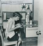 Bridgewater College, Christine Miller with an Infracord IR infrared spectrometer, 1960s by Bridgewater College