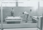 Bridgewater College, Students playing pool in the Kline Campus Center, taken through bookstore window, undated by Bridgewater College