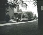 Bridgewater College, Rainy day scene of students walking in front of Alexander Mack Memorial Library, undated by Bridgewater College