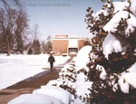 Bridgewater College, Snow scene of student walking across campus mall to the Alexander Mack Memorial Library, undated by Bridgewater College