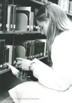 Bridgewater College, Student in the stacks at the Alexander Mack Memorial Library, undated by Bridgewater College