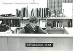 Bridgewater College, Alexander Mack Memorial Library student worker at circulation desk, undated by Bridgewater College