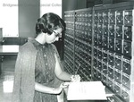 Bridgewater College, Student worker with shelf list in the Alexander Mack Memorial Library, undated by Bridgewater College