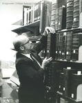 Bridgewater College, Library Director Orland Wages with historic materials in the Alexander Mack Memorial Library, undated by Bridgewater College