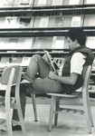 Bridgewater College, Student reading a periodical in the Alexander Mack Memorial Library, circa 1981 by Bridgewater College