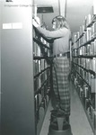 Bridgewater College, Student in stacks at the Alexander Mack Memorial Library, circa 1973 by Bridgewater College