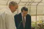 Bridgewater College, Biology professor Dr. L. Michael Hill shows Congressman Bob Goodlatte a plant in the greenhouse during a tour of the McKinney Center, 22 August 1996 by Bridgewater College