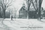 Bridgewater College, Person walking in snow outside Memorial Hall, undated by Bridgewater College