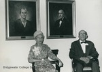 Bridgewater College, Leland C. Moomaw and Nina Kinzie Moomaw under their portraits by Robert B. Stevens in Moomaw Hall, probably 1970 by Bridgewater College