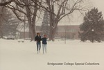 Bridgewater College, Two students walk through snow with Nininger Hall in the background, 1989 by Bridgewater College