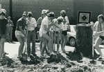 Bridgewater College, Students in pool-wear laugh as they break ground for the Nininger Hall swimming pool addition, 18 April 1979 by Bridgewater College