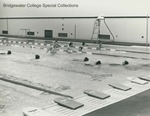Bridgewater College, Students in the Nininger Hall swimming pool while kickboards line the pool edge, undated by Bridgewater College