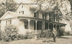 Bridgewater College, Postcard showing Paul H. Bowman standing outside the old President's House, undated by Bridgewater College