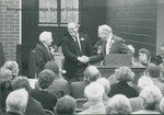 Bridgewater College, Wayne F. Geisert (right) and an unidentified man present key to Bertha D. Phibbs at the Paul V. Phibbs Maintenance Center Dedication, 1 November 1991 by Bridgewater College