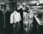 Bridgewater College, The Gallery (Winchester, Va) (photographer), Reuel B. Pritchett showing two fur coats in the Reuel B. Pritchett Museum, 1968 by The Gallery