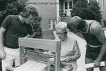 Bridgewater College, Pat Churchman (photographer), Lera Sanders demonstrating weaving outside the Reuel B. Pritchett Museum, undated by Pat Churchman