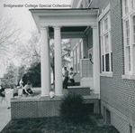 Bridgewater College, Students enter and leave Rebecca Hall dining room, leaving their books on the porch, probably 1962 by Bridgewater College