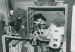 Bridgewater College, Gregg Riddiford (photographer), Pound Puppies and other stuffed animals displayed on a bookshelf in a student's residence hall room, December 1989 by Gregg Riddiford