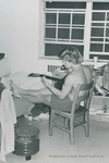 Bridgewater College, Student playing guitar in his residence hall room, undated by Bridgewater College