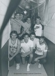 Bridgewater College, Men from Wakeman B Section pose in their hall at Christmas, 12 December 1985 by Bridgewater College