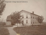 Bridgewater College, male residents posed around the first Wardo Hall which stood from 1890 - 1910 by Bridgewater College