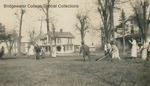 Bridgewater College students doing yardwork near the White House and old President's House on Cleanup Day, October 1923 by Bridgewater College