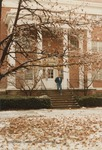 Bridgewater College, Student walking down steps of Wright Hall with a light snow on the ground, January 1985 by Bridgewater College