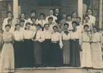 Bridgewater College, Photograph postcard with a group portrait of the first Yount Hall residents with Residence Hall matron Mattie Fry Wayland and her husband John W. Wayland at the top center, 1906 by Bridgewater College
