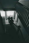 Bridgewater College, Photograph showing the silhouettes of two people descending Yount Hall stairs, 1980 by Bridgewater College