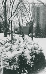 Bridgewater College, A student walking in snow by Yount Hall with Nininger Hall in the background, undated by Bridgewater College